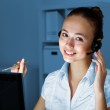 Young woman in business wear and headset — Stock Photo #8522248