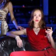 Young woman in night club with a drink — Stock Photo #8528015