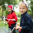 Boy on a bicycle in the green park — Stock Photo #8528292