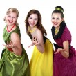 Three young woman in bright colour dresses - Stock Photo