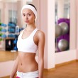 Young woman doing sport in gym — Stock Photo #8529368