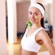 Young woman doing sport in gym — Stock Photo #8529393