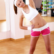 Young woman doing sport in gym — Stock Photo #8529399