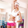 Young woman doing sport in gym — Stock Photo #8529401
