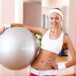 Young woman doing sport in gym — Stock Photo #8529418