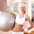 Young woman doing sport in gym — Stock Photo #8529433