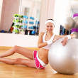 Stock Photo: Young woman doing sport in gym