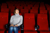 Young man in cinema watching movie — Stock Photo