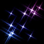 černé pozadí s zářící hvězdy — Stock fotografie