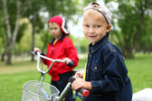 Boy on a bicycle in the green park — Foto de Stock