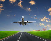 Plane on blue sky background — Stock Photo
