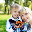 Young mother with her son in summer park — Stock Photo