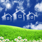 House from white clouds against blue sky — Foto de Stock