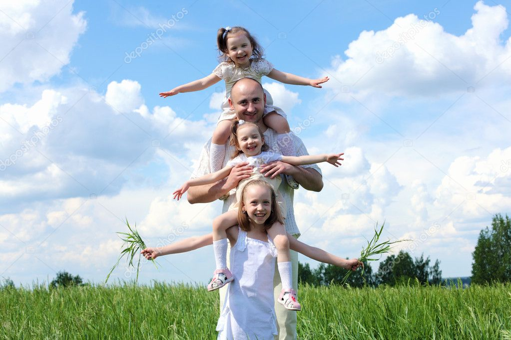 Family with children in summer day on the meadow  Stock Photo #8540417