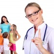 Doctor and family with children — Stock Photo #8559542