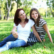 Mother with her daughter in summer park — Stock Photo #8559749