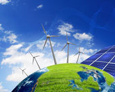 Planet earth with solar energy batteries — Stock Photo