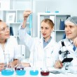 Young scientists working in laboratory — Stock Photo #8638271