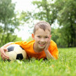 Little boy in the park with a ball - Stock Photo