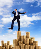Young businessman taking risky steps — Stock Photo