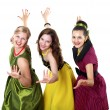 Royalty-Free Stock Photo: Three young woman in bright colour dresses