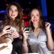 Young woman in night club with a drink — Stock Photo #8676860