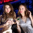 Stock Photo: Young woman in night club with a drink