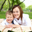 Mother with her son outside — Stock Photo #8677412