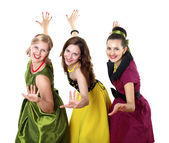 Three young woman in bright colour dresses — Stock Photo