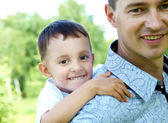 Father and son in the summer park — Stock Photo