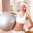 Young woman doing sport in gym - Stock Photo