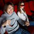 Stock Photo: Young couple in cinema watching movie