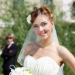 Portrait of a young bride in a white dress — Stock Photo #9080878