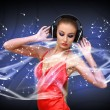 Young woman in evening dress with headphones — Stock Photo #9081313