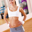Young woman doing sport in gym — Stock Photo #9086867