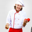 Portrait of a young cook in uniform - Foto Stock