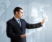 Businessman against technology background — Stock Photo