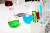 Chemistry laboratory equipment and glass tubes — Stock Photo