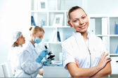 Young scientists working in laboratory — Stock Photo