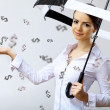 Business woman under money rain with umbrella - Stockfoto