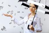 Femme d'affaires sous une pluie d'argent avec parapluie — Photo