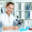 Young scientist working in laboratory — Stock Photo