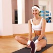 Young woman doing sport in gym — Stock Photo #9156099