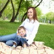 Mother with her son outside — Stock Photo #9156126