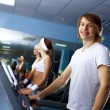 Young man doing sport in gym — Stock Photo #9188849