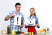 Husband and wife together coooking at home — Стоковое фото