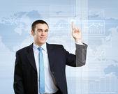 Homme d'affaires sur fond de technologie — Photo