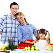 Family with a daughter cooking together at home — Stock Photo #9190255