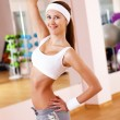 Young woman doing sport in gym — Stock Photo #9220147