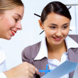 Young women in business wear working in office — Stock Photo
